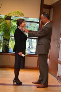 Josée Larsen receives Chevalier dans l'Ordre de Palmes Académiques award from the French Consul