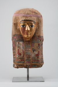 Mummy mask - linen cartonnage with gilding and inlaid glass eyes Roman Period, ca. 50 B.C. - 150 A.D., photo credit HMNS
