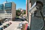 Optical camera on wall of building watching on parking place from top