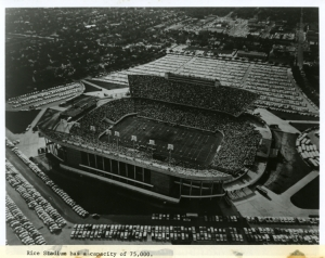 Rice University Stadium aerial view with caption regarding capacity of 75,000, 1970.
